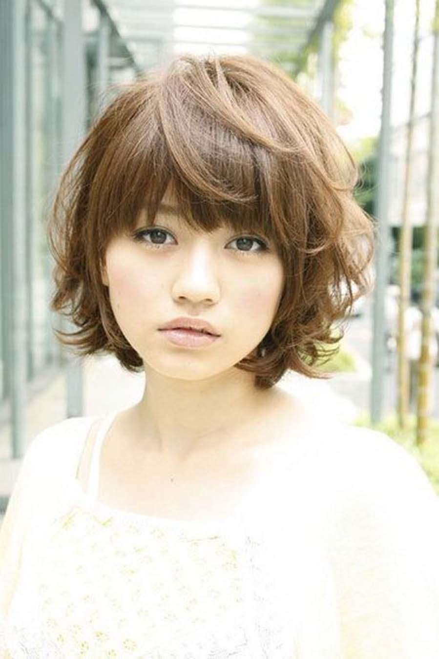 Photo coupe cheveux femme visage rond